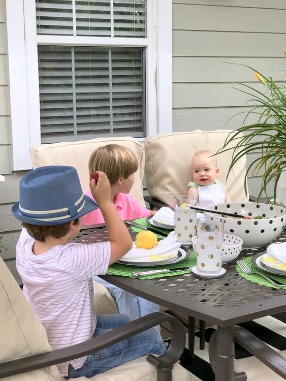 Children enjoying lemonade on their back deck