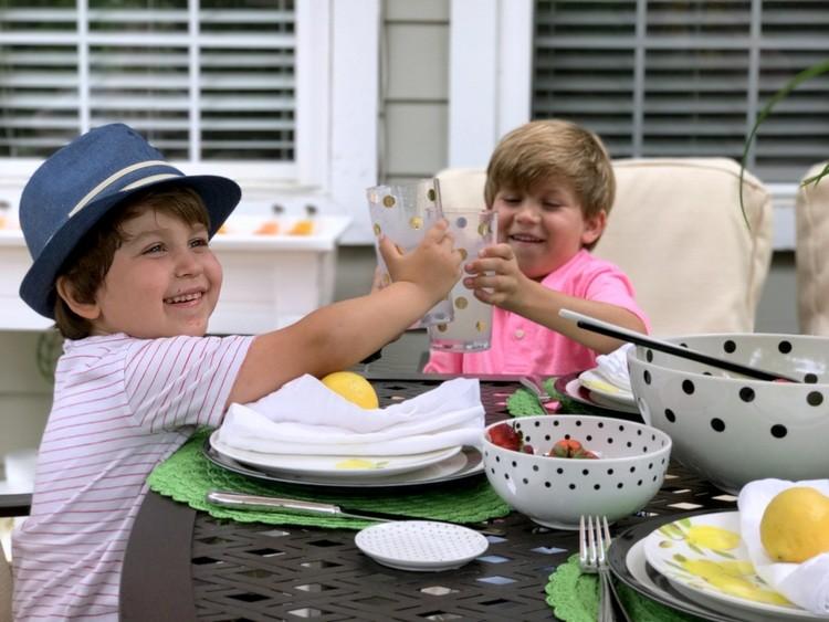 Boys enjoying lemonade on the back deck