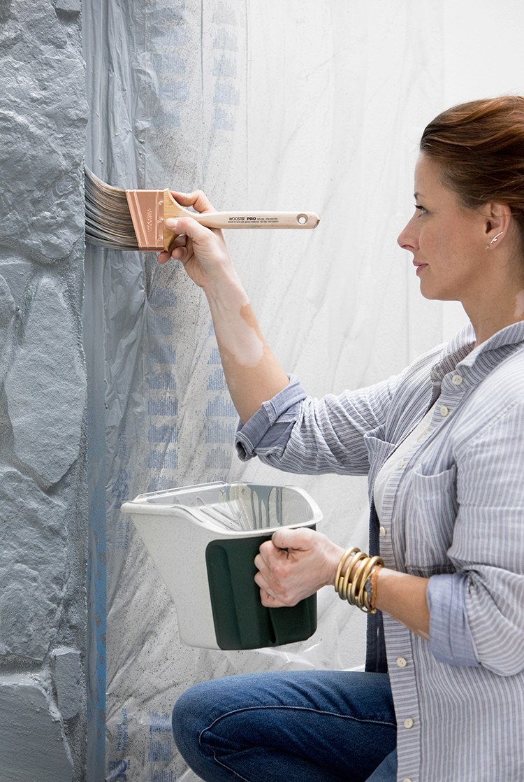 Painting the edge of a stone fireplace