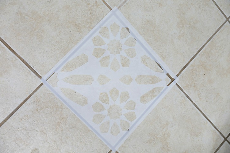 Stencil lying on a tile floor
