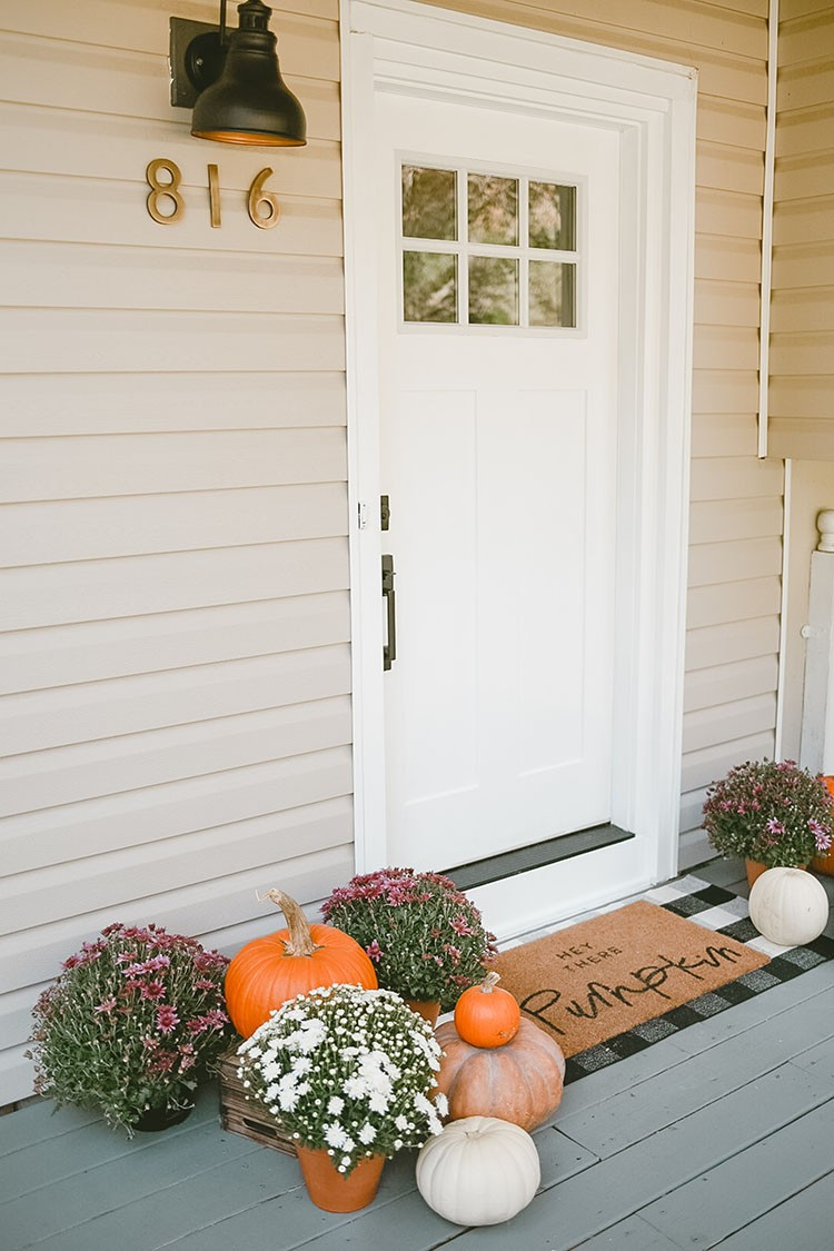 Caitlin Kruse has been wanting to replace her front door since they moved in. With a few simple upgrades, Caitlin's porch is now festive and ready for Fall.