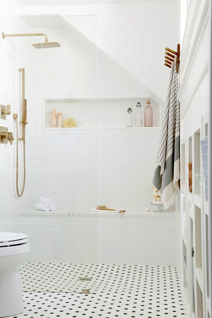 Cristina Garay takes on a walk-in shower install project in just six steps! Learn how she took to transform her bathtub into a beautiful walk-in shower.