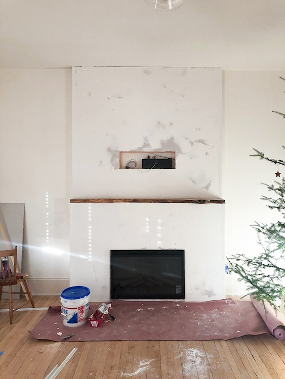 Jenni Radosevich of I SPY DIY transforms her living room into a warm and inviting space by adding a minimalist electric fireplace.