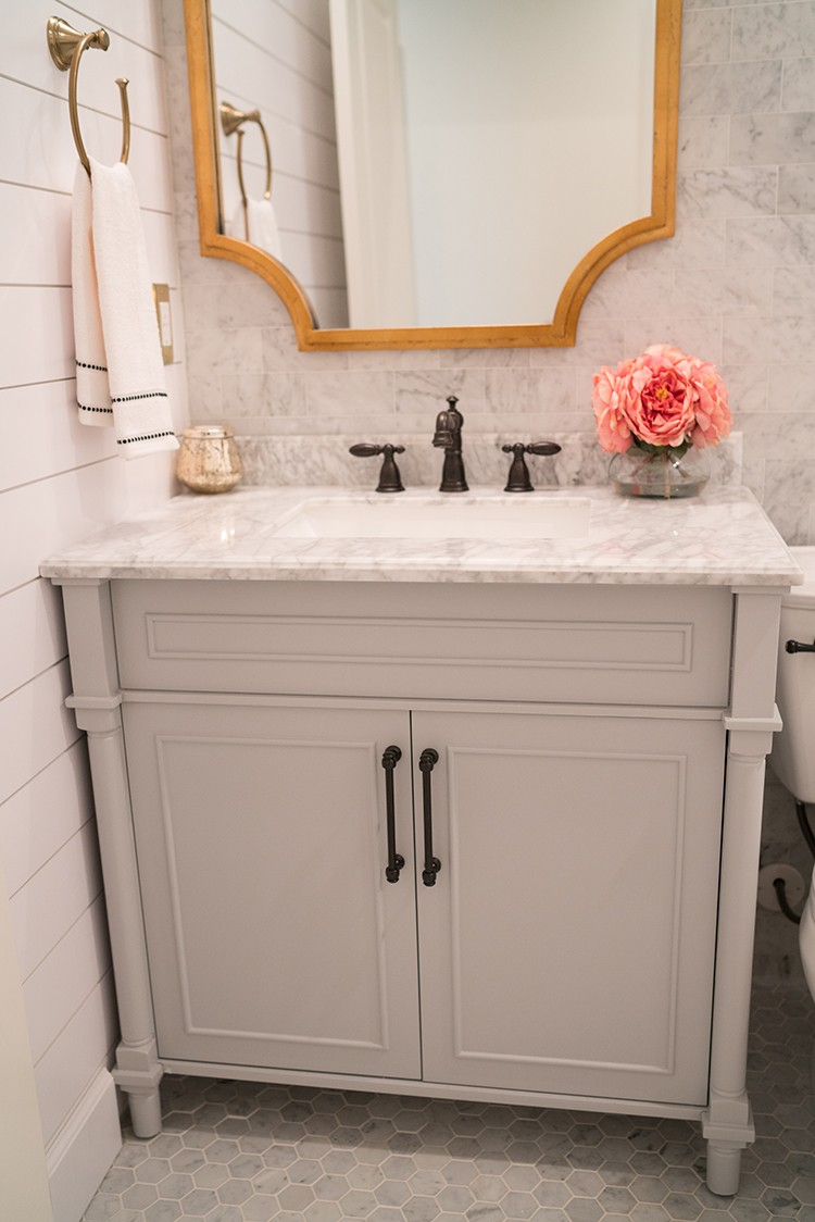 Katelyn Jones of A Touch of Pink takes on a beautiful bathroom remodel starring the Delta UPstile Wall System. Read below to see the full transformation from the demo to the final finished space.